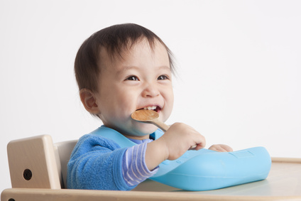 Cute baby with spoon